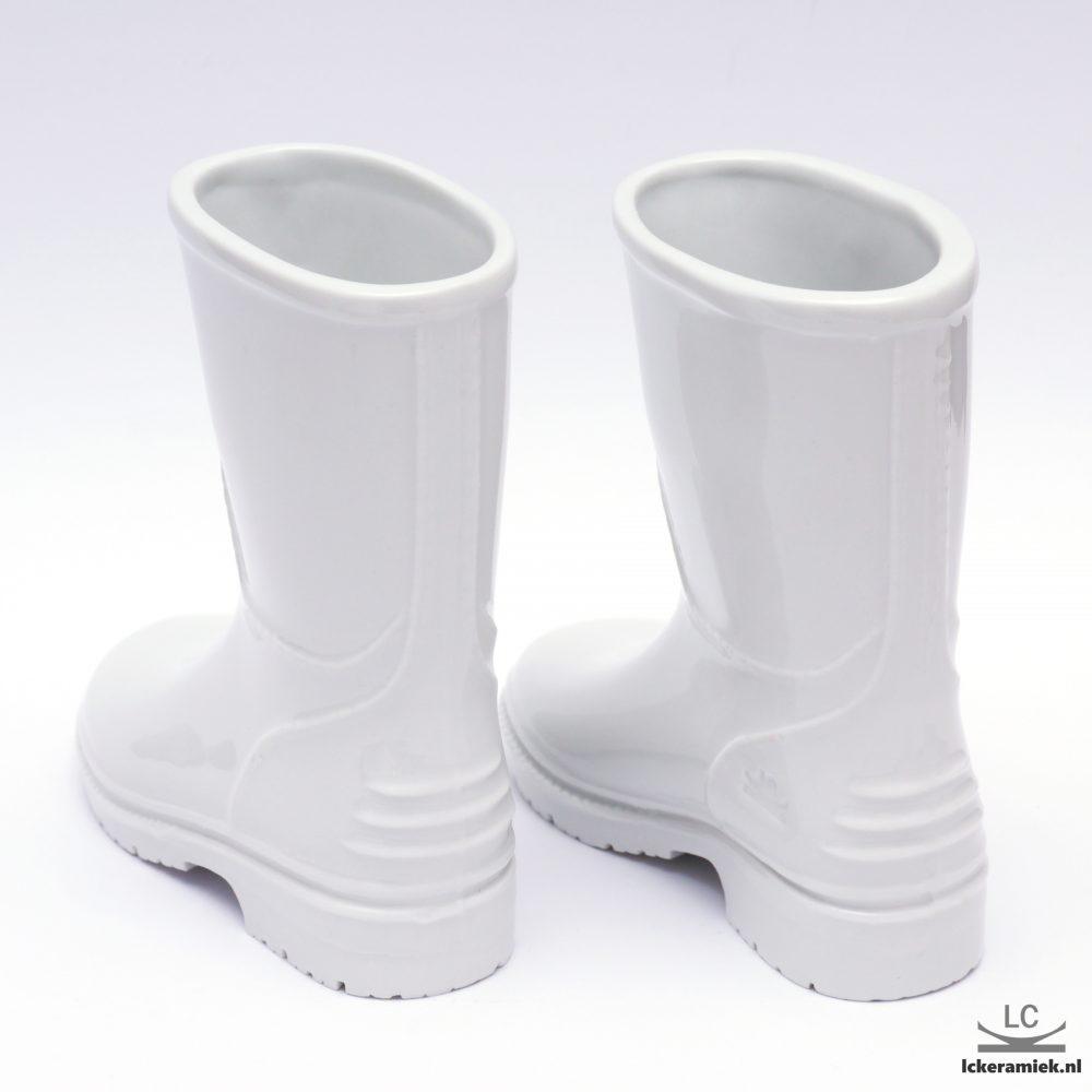 Porseleinen vaasje witte laarzen